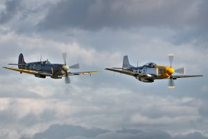 """OFMC Spitfire IX MH434 and P-51D Mustang """"Ferocious Frankie"""" perform at the Old Buckenham Airshow"""